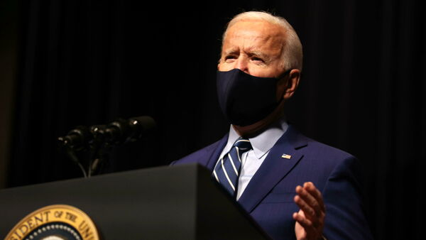 US President Joe Biden talks to staff at the National Institutes of Health, in Bethesda, Maryland, USA, 11 February 2021. EPA
